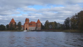 Trakai castle on the lakes is visited by hundreds of thousands of tourists every year. Trakai, Lithuania - October 16, 2016: Trakai castle on the lakes is stock video footage