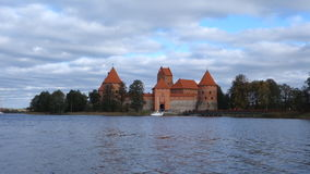 Trakai castle on the lakes is visited by hundreds of thousands of tourists every year. Trakai, Lithuania - October 16, 2016: Trakai castle on the lakes is stock footage