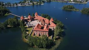 Lithuania. Trakai. Flight over beautiful castle on an island on a lake. Aerial view of Trakai castle in summer season. Trakai castle, Lithuania. Beautiful stock video footage