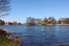Trakai castle and old house on the lake shore. Situated not far from Vilnius, Trakai is an ancient capital of the Grand Duchy of Lithuania Royalty Free Stock Images