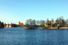 Trakai castle and old house on the lake shore. Situated not far from Vilnius, Trakai is an ancient capital of the Grand Duchy of Lithuania Royalty Free Stock Photography
