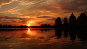 Trakai castle and sunset, Lithuania. Trakai castle and sunset pan, Lithuania stock video