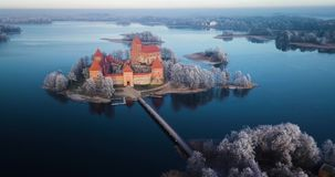 Above Trakai castle at winter, aerial. Trakai castle at winter, aerial view above the castle stock video footage