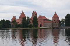 Trakai island castle at the lake. Reflection in water. stock photos