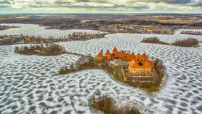 Trakai, Lithuania: aerial winter UAV top view, flat lay of gothic Island Castle and city of Trakai. In the winter royalty free stock photography