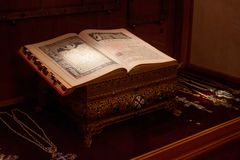 TRAKAI, LITHUANIA - JANUARY 02, 2013: Ancient book in Museum of Sacred Art. Ancient book in Museum of Sacred Art part of the Trakai Historical Museum, opened in royalty free stock image