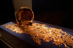 TRAKAI, LITHUANIA - JANUARY 02, 2013: Ancient medieval golden coins in the Historical Museum in Trakai stock photos