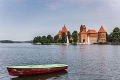 Trakai red brick castle with a boat in front Royalty Free Stock Photo