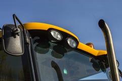 Traktor beleuchtet zur Sicherheit der Halogenlichtbewegung Stockfotos
