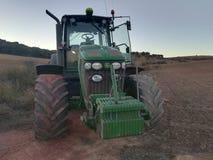 Traktor i skörden Royaltyfri Foto