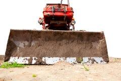 Traktor mit einem Blatt auf dem Boden Stockfoto