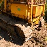 Traktor-Raupen-Stier-Bulldozer-Seitenansicht Stockfotos