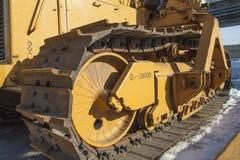 traktoren står på snön Arkivfoto