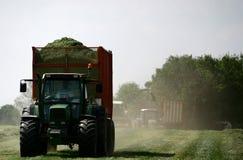 Traktoren und Heuwagen Stockbild