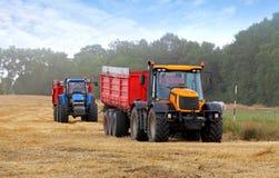 Traktorer på skörd Royaltyfria Bilder