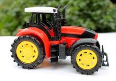 Traktorleksak för barn Fotografering för Bildbyråer