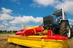 Traktoror on the field Stock Images