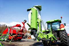 Traktors and plows. Farming machinery, tractors, plows and mowers Stock Images