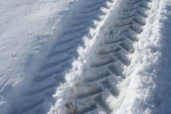 Traktorspur am Schnee Lizenzfreie Stockfotografie