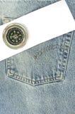 Tralicco blu con documento e la bussola Fotografia Stock