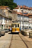 Tram. Old tram front view on a picturesque street vy the river Douro, in Oporto, Portugal royalty free stock photo