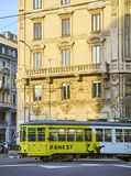 A tram advertising a monographic exhibition of Banksy crossing Via Giovanni Boccaccio. Milan, Lombardy, Italy stock image