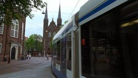 Tram in Amsterdam city center  City of Amsterdam. Tram in Amsterdam city center  Amsterdam Netherlands videoclip stock video
