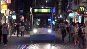 Tram approaching by night  City of Amsterdam stock footage