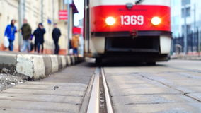 Tram arrival. The arrival of a tram to the tram stop in Moscow stock footage