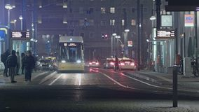 Tram Arriving At Berlin Alexanderplatz Station. Tram Arriving At Berlin Alexanderplatz At Night And Another Tram Passes By Left To Right stock footage