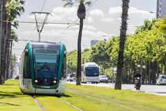 Tram in Barcelona. Barcelona, Spain - May 21, 2015: Barcelona tram known as Trambaix. In the picture the tram is going through the Diagonal avenue  in Barcelona Royalty Free Stock Images