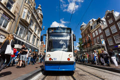 Tram on a busy street of Amsterdam Stock Photography