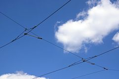 Tram cables against blue sky. Stock Photo