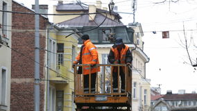 Tram cables workers repairing. Sofia, Bulgaria - November 28, 2016: Workers in uniforms repair the electricity cables for the tram cars stock video