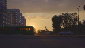 Tram car drive by against setting sun stock video footage