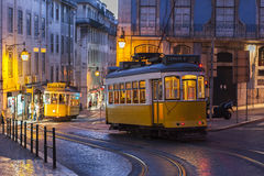 Tram car on street at evening in Lisbon, Portugal. Tram car crossing on street at evening in Lisbon, Portugal Royalty Free Stock Image
