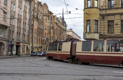 Tram cars go through the city streets of St. Petersburg, buildin. Gs, electrical wires, cityscape Stock Photo