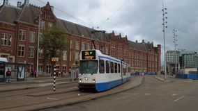 The tram in the city of Amsterdam at Central Station - AMSTERDAM - THE NETHERLANDS - JULY 19, 2017. The tram in the city of Amsterdam at Central Station stock video footage