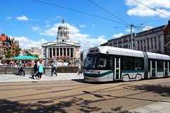 Tram by City Hall, Nottingham. Modern tram passing the Council House also known as the city hall in the Old Market Square, Nottingham, Nottinghamshire, England Royalty Free Stock Photo