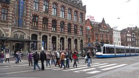 Tram on a city street. Amsterdam. AMSTERDAM, NETHERLANDS - SEPTEMBER 30, 2017: Tram on a city street stock footage