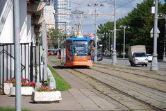 The tram on the city street Moscow. Summer sunny day Stock Photo