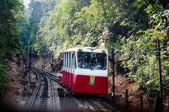 A tram coming down from Penang hill. Red and whtie tram of penang coming down from penang hill Stock Images