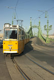 Tram coming from Freedom Bridge in Budapest Royalty Free Stock Photography