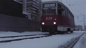 Tram coming up to camera on winter way. Novosibirsk, Russia - December 2, 2015: Tram rides in winter. Full HD Resolution 1920×1080 Video Frame Rate 29.97 Length stock video