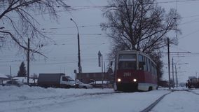 Tram coming up to camera on winter way stock footage