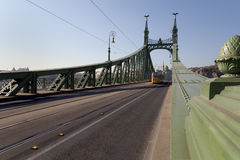 Tram crossing liberty Bridge in Budapest. Liberty Bridge is the third and shortest bridge of Budapest. It was built for the Millennium World Exhibition in 1896 Stock Photo