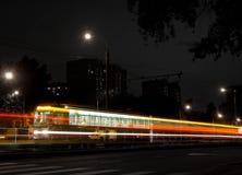 Tram and crosswalk at night, black and white Stock Image