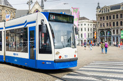 Tram in Dam Square on a Sunny Day Stock Photography