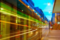 Tram departs from a stop on street Stock Images