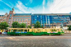 Tram departs from a stop on street Royalty Free Stock Images